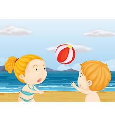 Children playing volleyball at the beach vector image