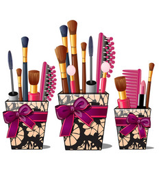 Makeup brushes mascara comb in box with pink bow vector