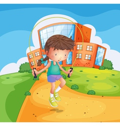 A young girl playing at the school ground vector image