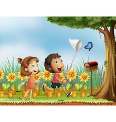 Children trying to catch a butterfly vector image
