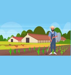male gardener using hoe countryman hoeing ground vector image