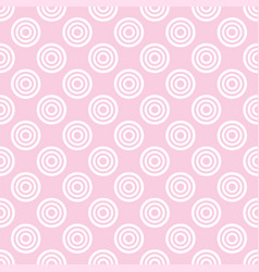 Seamless pattern with white polka dots on a pink vector