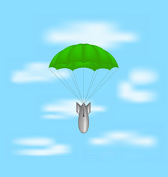 bomb at green parachute on blue sky vector image