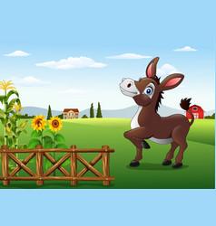 cartoon happy donkey with farm background vector image