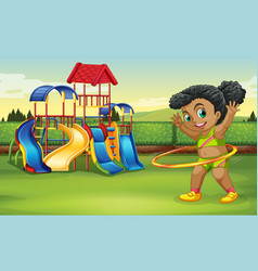 a girl doing hula hoop at the park vector image