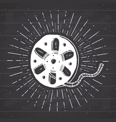Cinema tape and film reel vintage label hand vector