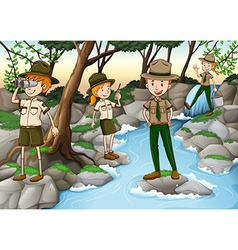 Park rangers standing at the waterfall vector