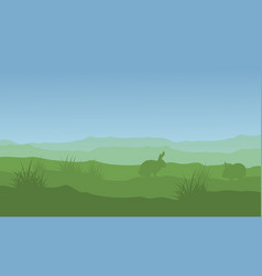 Silhouette of rabbit and easter landscape vector