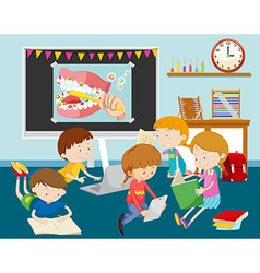 Children working on computer in classroom vector image