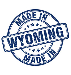 Made in wyoming blue grunge round stamp vector