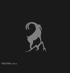 Ibex on mountain logo vector