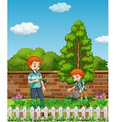 Father and son watering plants in garden vector