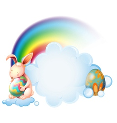 A bunny hugging an easter egg near the rainbow vector image vector image