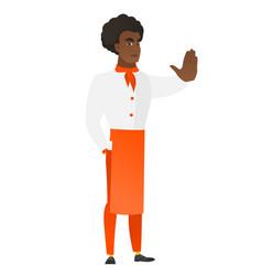 African chef cook showing stop hand gesture vector