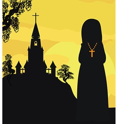 Nun praying in front of the church vector