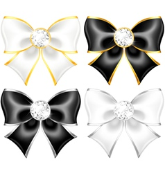 White and black bows with diamonds and gold edging vector image