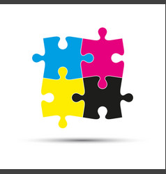 abstract logo four puzzle pieces in cmyk colors vector image vector image