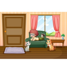 A young boy and his cats inside the house vector image