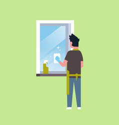 man in gloves and apron cleaning window with rag vector image