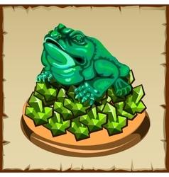 One frog figurine sitting on emerald vector image vector image
