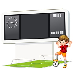 A boy playing soccer at the court vector image