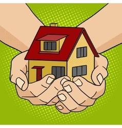 House in hands pop art style vector image