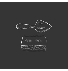Spatula with brick Drawn in chalk icon vector image