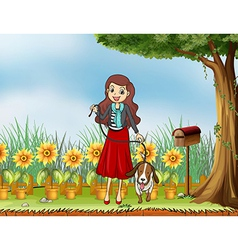 A woman with a dog at the garden vector image