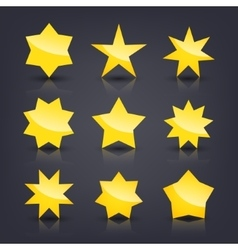 Set of yellow glossy stars vector