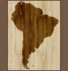 South america map on wood background vector