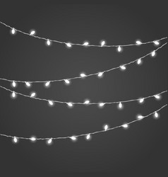 different white lighting garland set on dark vector image