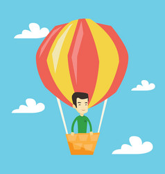 young man flying in hot air balloon vector image