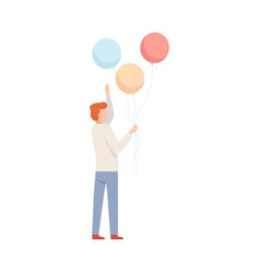 young man holding coloful balloons party concept vector image