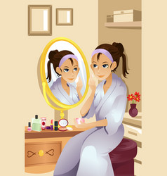 woman applying makeup vector image