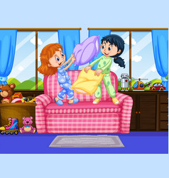 Two girls in pajamas playing pillow fight in room vector