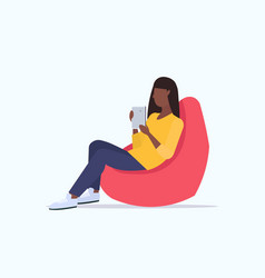 woman sitting in bean bag armchair african vector image