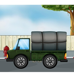 A green track with a cargo at the back vector image