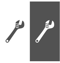 Wrench icon on black and white background vector