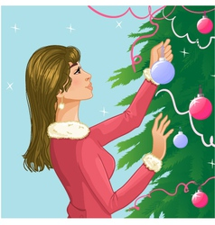 Young woman decorates a christmas tree with balls vector image
