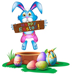A rabbit holding an easter greeting vector image vector image