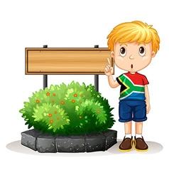 Little boy standing next to sign vector