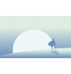 Silhouette of Santa with big moon scenery vector image