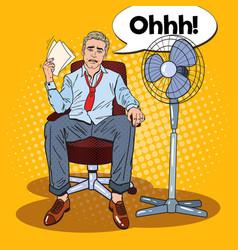 pop art sweating businessman in front of fan vector image vector image