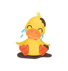 Cute little yellow duckling character sitting in a vector
