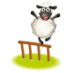 A sheep standing above the wooden fence vector
