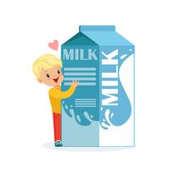 Cute blonde little boy and funny milk carton box vector