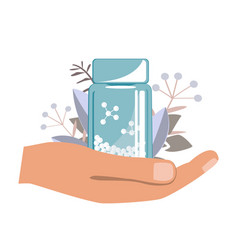 Hand with bottle with gomeophatic granules vector