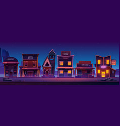 western town with old buildings at night vector image