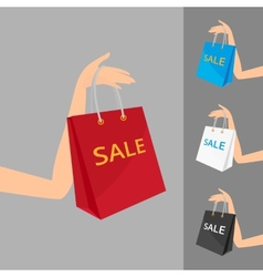 Red shopping bag in womens hand and three vector image