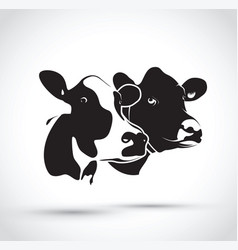 Set of two abstract cow heads vector